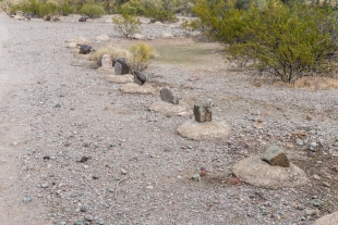 Rocks in cement to mark the road, Crystal Hill Area, Kofa National Wildlife Refuge, Arizona