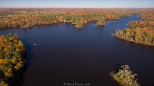 Drone view of fall colors on Long Lake near Mercer, Wisconsin