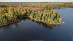 Drone view of East Twin Lake Campground near Clam Lake, Wisconsin showing fall colors
