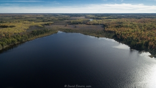 Drone view of East Twin Lake near Clam Lake, Wisconsin showing fall colors