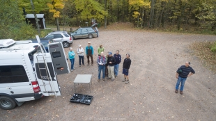 Group assembled to watch drone demonstration at Morgan Falls trailhead parking, Lincoln, Bayfield County, Wisconsin