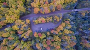 Drone view of Morgan Falls trailhead parking, Lincoln, Bayfield County, Wisconsin showing fall colors