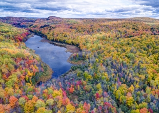 Drone view near Morgan Falls trailhead parking, Lincoln, Bayfield County, Wisconsin showing Beaver Pond and St Peter's Dome in the distance