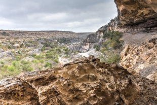 Wind-eroded rock above canyon, Guided tour, Seminole Canyon State Park, Texas