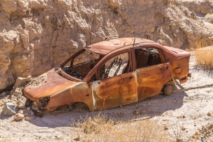 Abandoned rusted car in side canyon, Mecca Hills Wilderness, Box Canyon Road, California