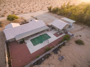 Drone view of nice property with a pool, Yuma, Arizona