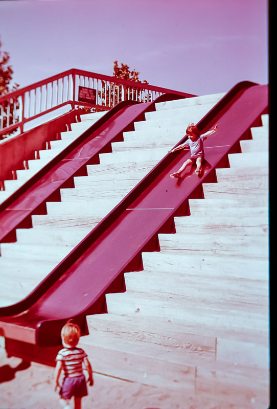 Andrew on slide in Rochester downtown park  1978