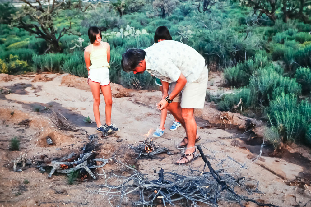 Harold Bentley and daughters building dinner fire - May 1979