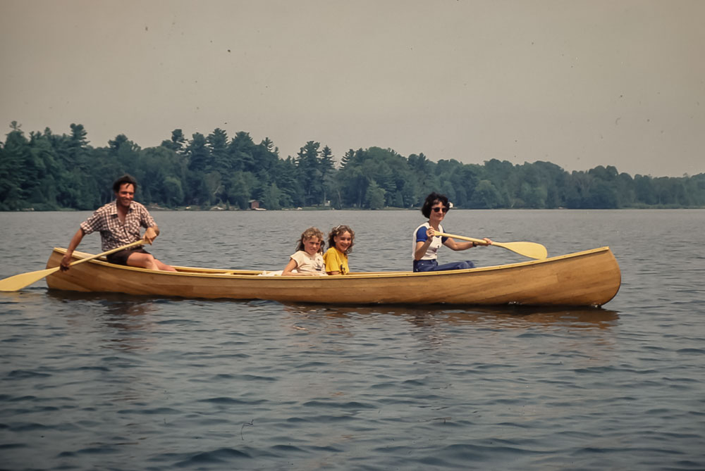 Wahlens leaving island in handmade canoe - August 1982