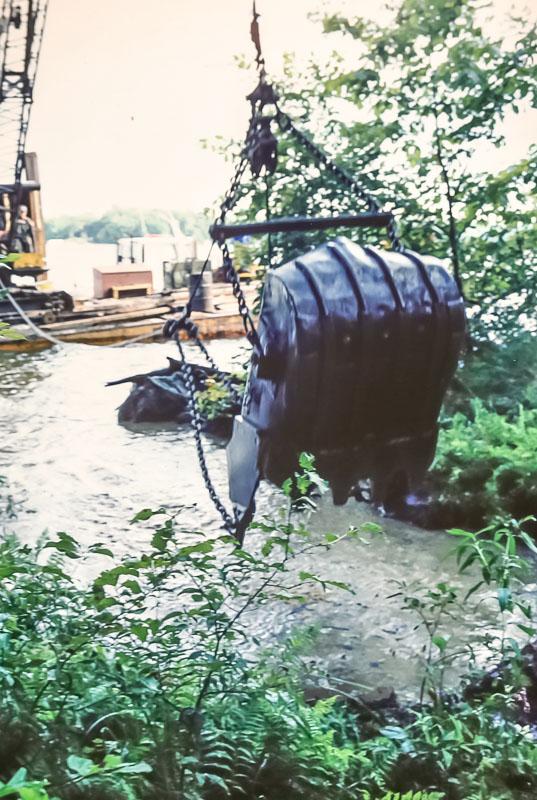 Dredging out boat dock area- September 1982