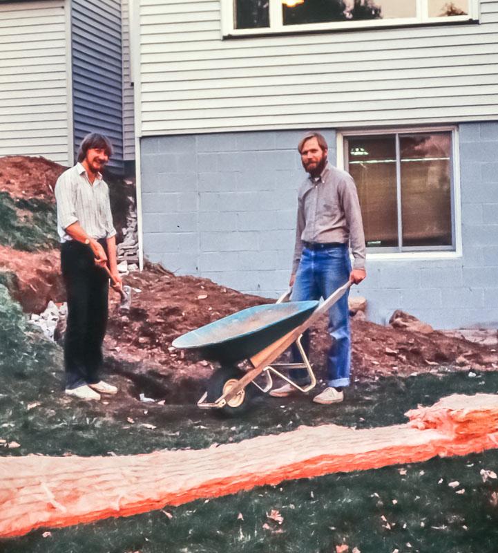 Peter Kucik and David improving drainage at back of a Danforth House - October 1983